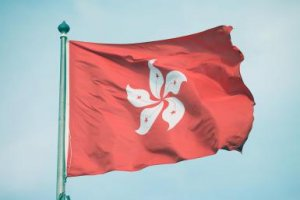 The Hong Kong flag waves in the wind. - Kick Images/Photodisc/Getty Images
